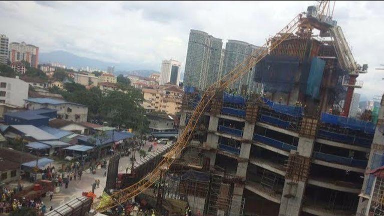 Kuala Lumpur khuasung aom Construction khat ah akizang Crane tuksuk, numeikhat liam